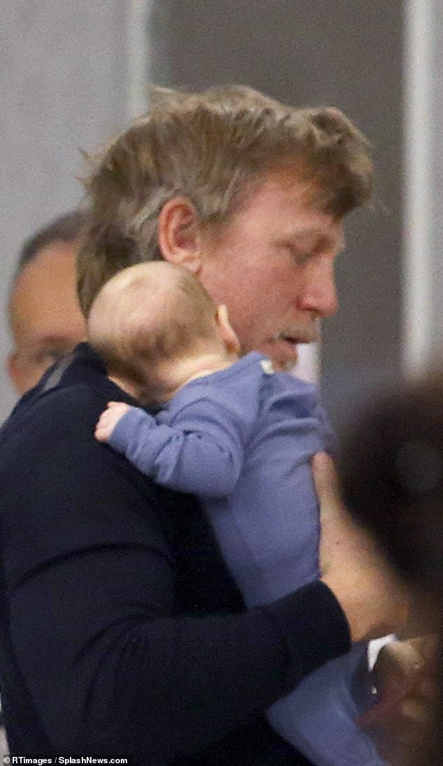 Craig, pictured with his daughter, will receive a reported £20 million to star in the 25th Bond film next year