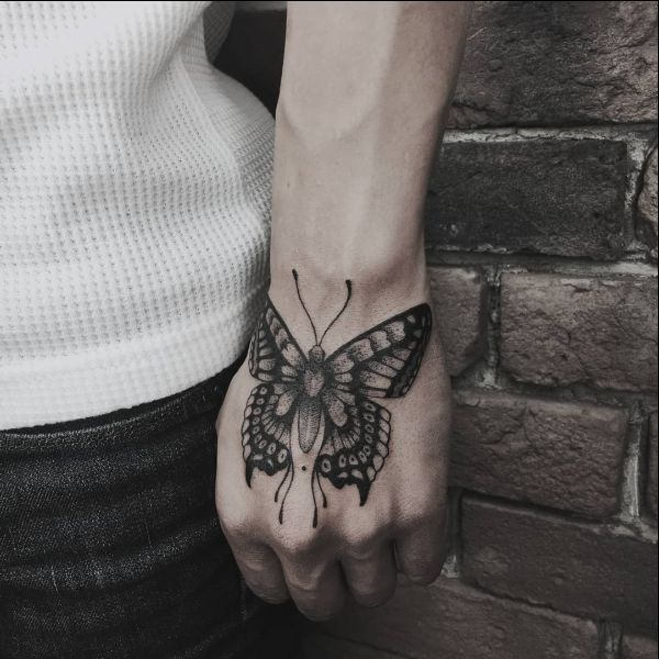 cute butterfly hand tattoos for women