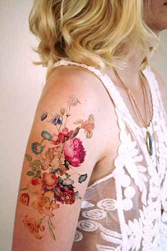 colorful flower tattoo on upper arm
