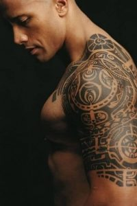 "Dwayne ""The Rock"" Johnson proudly displays for his large, traditional Polynesian tattoo"