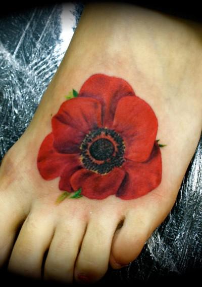 http://tattooinfo.ru/images/foto_cvetnaja_tatu_v_vide_maka_na_stupne.jpg