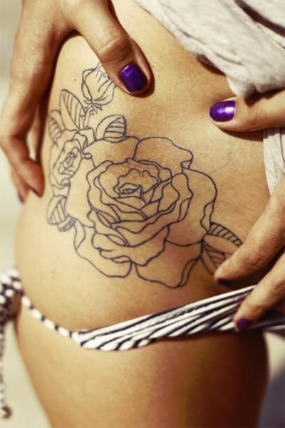 Фото татуха <strong>тату для рыжих девушек</strong> розы на боку у девушки